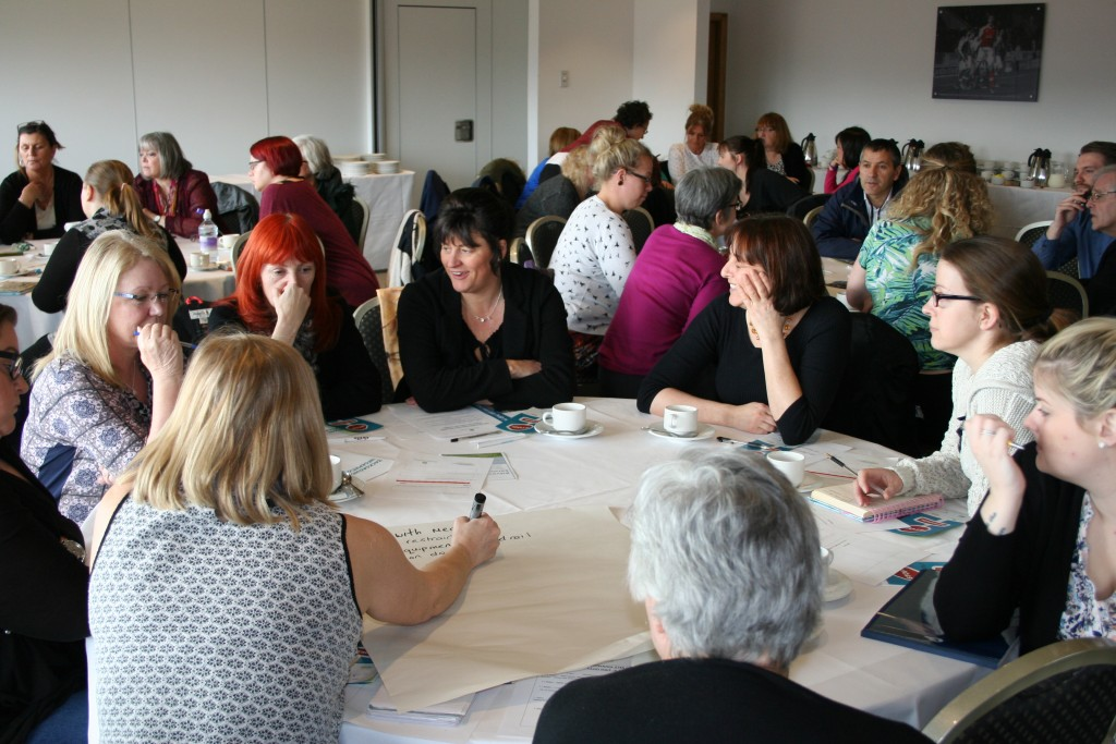"An image of people in small groups, discussing issues around restraints, at the launch of the Let's Talk About Restraints"" online training toolkit, which took place at Rotherham Football Stadium in March 2016."